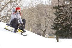 Teens sliding in winter Royalty Free Stock Image