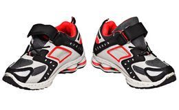 Teens sneakers with red elements Stock Image