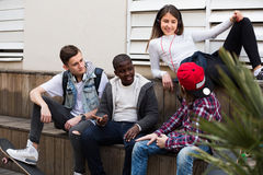Teens  spending time together  in sunny day Stock Images