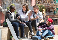 Teens spending time together in sunny day Royalty Free Stock Image