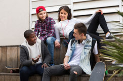 Teens spending time together  in sunny day Royalty Free Stock Photography