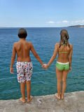 Teens in summer love. Teens, boy and girl, ready for jump in sea on vacation in Croatia Stock Photography