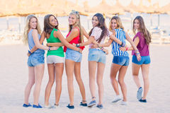 Teens on summer vacation. Group of teens at beach on summer vacation Royalty Free Stock Photo