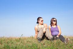 Teens with sunglasses. Cute teens looking to left Royalty Free Stock Photography