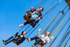 Young girls on the swing carousel Royalty Free Stock Images