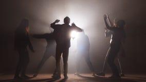 Teens taking part in dancing battle outside. stock video