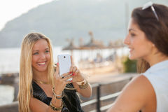 Teens taking photos with generic smart phone Stock Photos