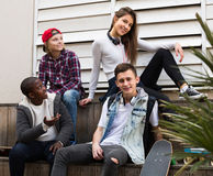 Teens talking in sunny day. Teens spending time together and talking in sunny day Stock Photos