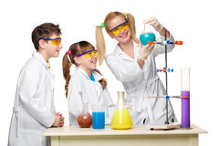 Teens and teacher of chemistry at  lesson making Stock Image