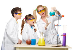 Teens and teacher of chemistry at  lesson making Royalty Free Stock Photos