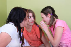 Teens telling secrets Stock Photo