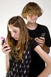 Teens Texting on Cell Phone Royalty Free Stock Images