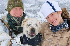 Teens and their dog. Brother , sister and their wheaten terrier dog Royalty Free Stock Photos