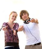 Teens With Thumbs Up Stock Photography