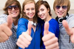 Teens with thumbs up. Friends showing thumbs up sign Royalty Free Stock Image