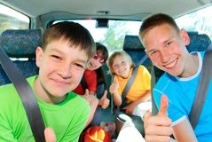Teens traveling. Four teens traveling by car Royalty Free Stock Images