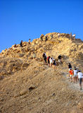 Teens trekking up a mountain Royalty Free Stock Photos