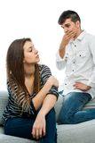 Teens with upset faces. Close up portrait of teen couple having disagreement. on white background Royalty Free Stock Images