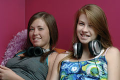 Teens using electronics Royalty Free Stock Photos