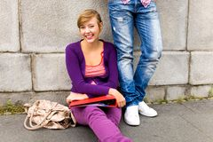 Teens by the wall Royalty Free Stock Photos