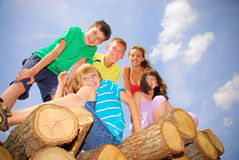 Teens on wood. Teenagers together on wood pale Stock Images