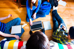 Teens work on project Royalty Free Stock Photo