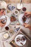 Teeparty mit Muffins Stockbilder