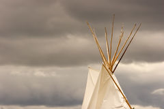 Teepee. Top of a teepee with stormy clouds in the background stock photo