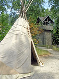 Teepee. In a forest with a wooden fort behind Royalty Free Stock Photography