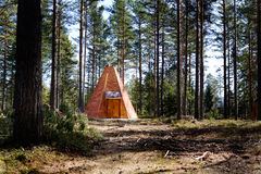 Teepee Cabin in Forest Stock Images