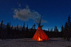 Teepee in the forest at night. Teepee in the forest at the beginning of night stock photo