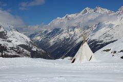 Teepee high in the Swiss Alps Royalty Free Stock Image