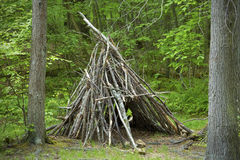 Teepee shelter made from stacked branches, Devi'ls Hopyard, Conn Royalty Free Stock Images