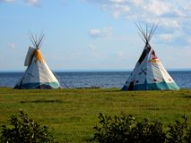 Teepee on the side of the water royalty free stock photography
