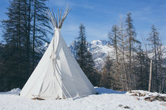 Teepee in the snow vintage Royalty Free Stock Image