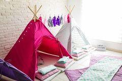 Teepee Tents For Pajama Party At Home. Pink and white teepee tents for pajama party at home stock photography