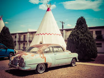 TeePee Vintage Car Wigwam Motel. Wigwam Motel on Route 66 in Holbrook, Arizona. The rooms of this hotel are built in the form of tipis royalty free stock image