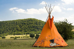 Teepee or wigwam. Indian ethnic domicile, teepee AKA wigwam on the meadow royalty free stock photography