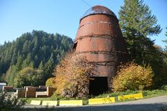 Abandoned Teepee/wigwam burner in Southwestern Oregon. Teepee or wigwam burners are used to dispose of waste wood in logging yards and sawdust from sawmills by stock photos