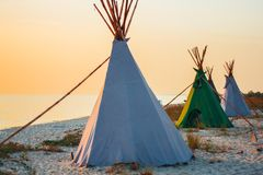 Teepees on the sea shore. In the summer stock photos
