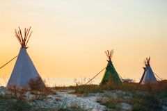 Teepees on the sea shore. In the summer stock photography