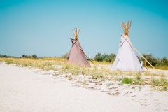 Teepees on the sea shore. In the summer royalty free stock photo
