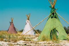 Teepees on the sea shore. Three teepees on the sea shore royalty free stock images