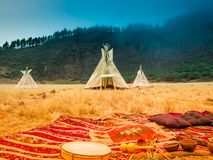 American native tent camp teepees. Teepees tent camp, home of the ancient Native Americans royalty free stock photo