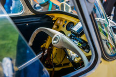 Teering wheel and an interior of an old European two seater hybrid car-bike. Color and beauty of vintage cars. Steering wheel and an interior of an old European stock photo