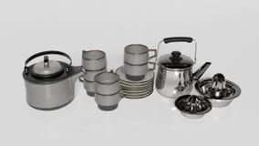 Teesatz, Teekannen mit Teeschalen, Untertassen und Zitronenquetscher Lizenzfreie Stockfotografie
