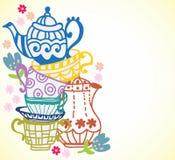 Teeschalenhintergrund mit Teekanne Stockfotos