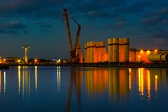 Teesside docks at night. River Tees industrial area. Nice reflections on the water Stock Image