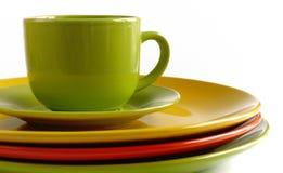 Teetasse und Untertasse und große Platten Stockfotos