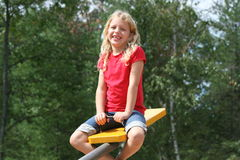 Teeter totter girl Stock Photography